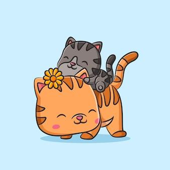 Chat avec petite pince à cheveux fleur de soleil jouant au chat gris