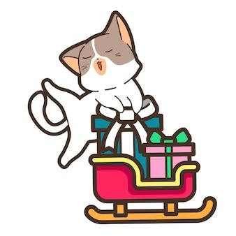 Chat et traîneau le jour de noël