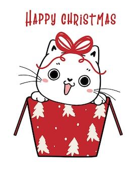 Chaton chat ludique mignon avec de grands yeux dans une boîte cadeau dessinée à la main et bonne année