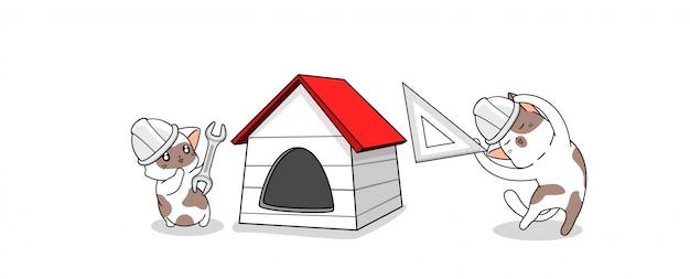 Les chats adorables construisent la maison