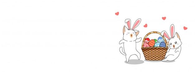 Les chats adorables portent des oreilles de lapin avec beaucoup d'oeufs dans le panier