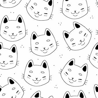 Les chats de dessin animé doodle noir et blanc sans couture font face à un modèle sans couture sur fond blanc