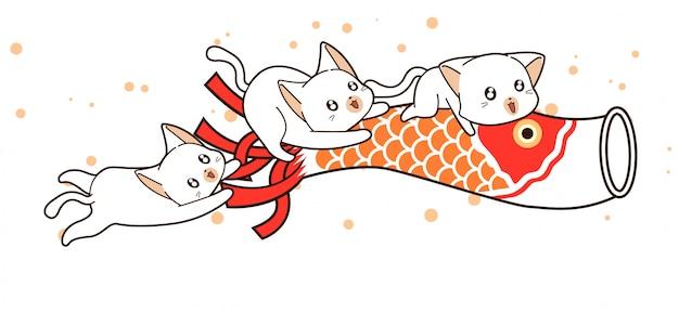 Les chats kawaii chevauchent la carpe en papier