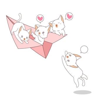 Chats kawaii dessinés à la main sur l'avion en papier