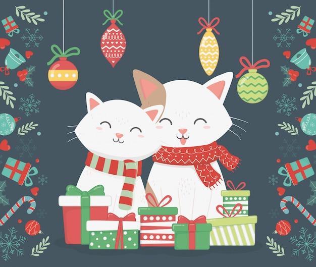 Chats mignons avec des cadeaux et illustration de boules suspendues