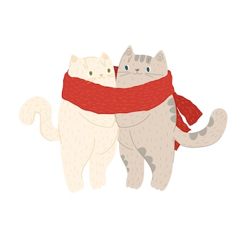 Les chats se blottissent dans une écharpe chaude en hiver ou en automne les chats aiment noël et le nouvel an tricoté chaud