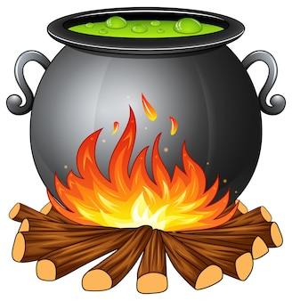Chaudron avec potion verte bouillante sur le feu de bois