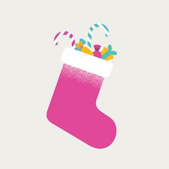 Chaussette colorée de noël pleine de bonbons et de cadeaux