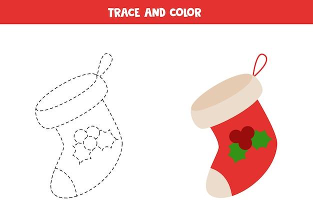 Chaussette de noël de dessin animé de trace et de couleur. feuille de travail pour les enfants.