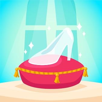 Chaussure en verre de cendrillon sur coussin rouge