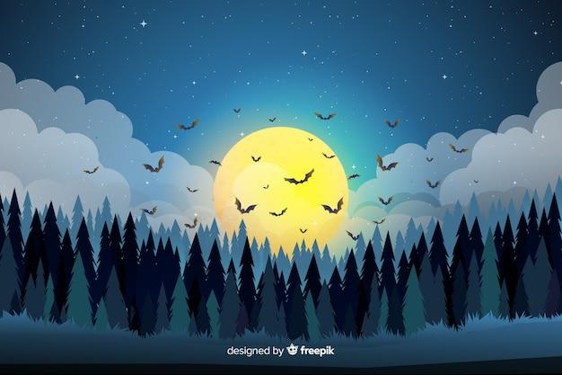 Chauves-souris au-dessus de la forêt fond d'halloween plat