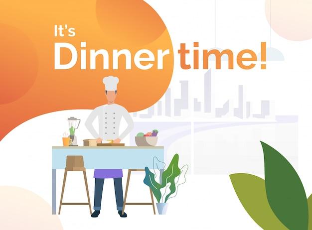 Chef cuisinant dîner dans la cuisine et couper du pain
