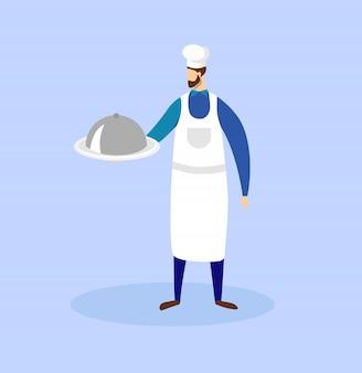 Chef tenant dans les mains plateau avec plat sous cloche.