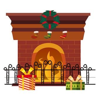 Cheminée de noël isolée avec des décorations de vacances et des cadeaux.