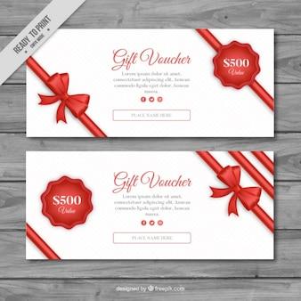 Chèque cadeau avec un ruban rouge