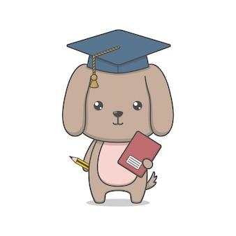 Chien chiot mignon portant un chapeau de graduation et tenant un livre et un crayon