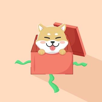 Chien mignon dans la boîte rouge illustration présente de noël