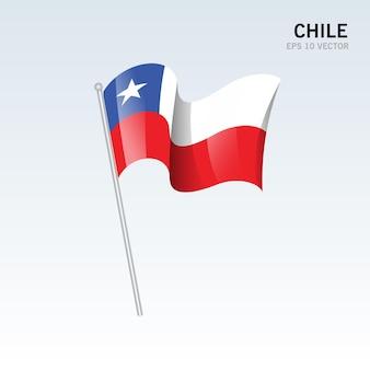 Chili, agitant le drapeau isolé sur gris
