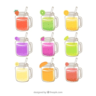 Choix à la main de délicieux jus de fruits