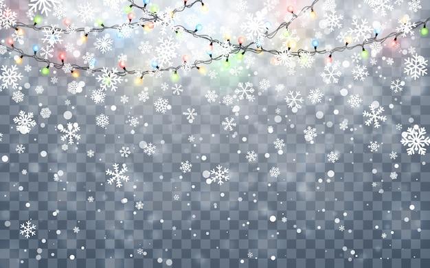 Chute de flocons de neige blancs sur fond sombre