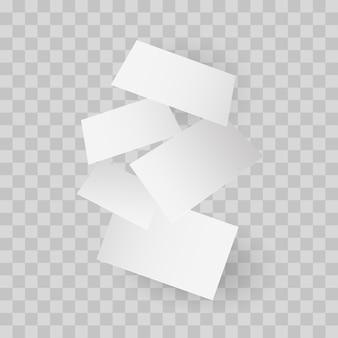 Chute de modèle de cartes de visite réaliste avec une ombre réaliste sur fond quadrillé.