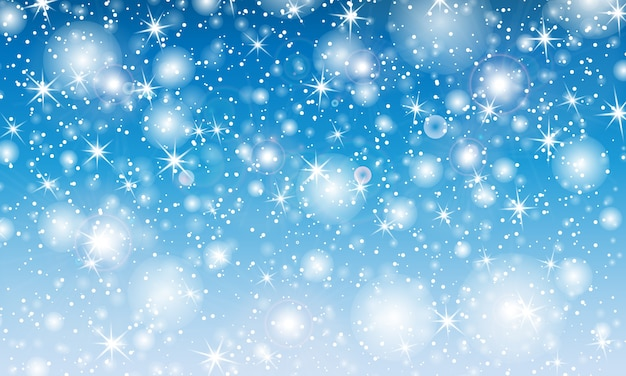 Chute de neige. avec des flocons de neige. ciel bleu d'hiver. texture de noël. fond de neige scintillante.