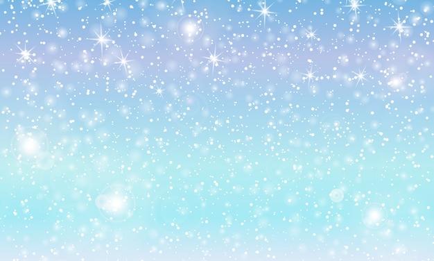 Chutes de neige avec des flocons de neige. ciel bleu d'hiver. texture de noël. fond de neige scintillante.