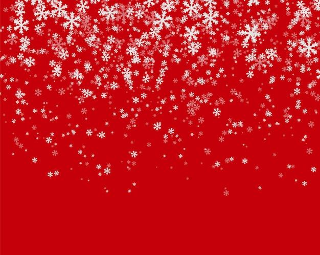 Chutes de neige sur fond rouge