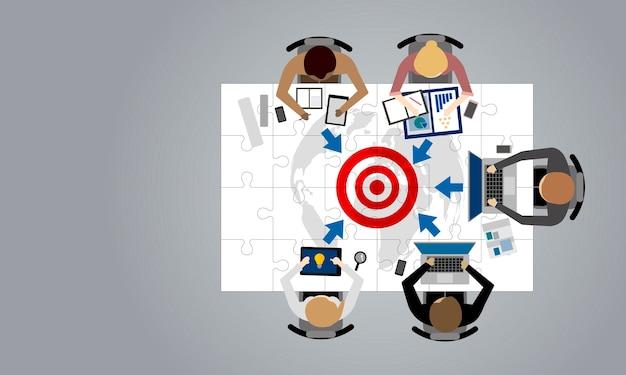 Cible d'affaires et le concept de travail d'équipe de gens d'affaires dans la salle de réunion