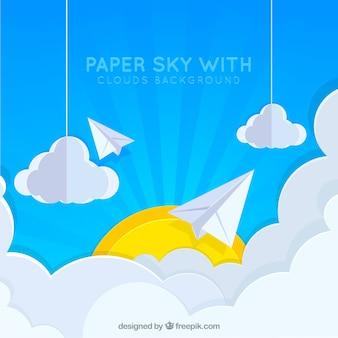 Ciel avec nuages et soleil fond en texture de papier
