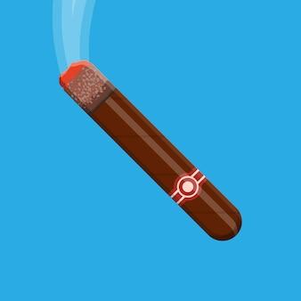Cigare fumant. cigare de cuba marron avec étiquette.