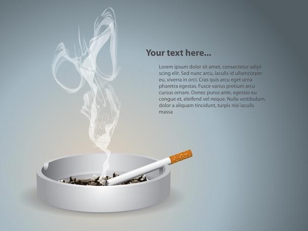 La cigarette allumée est sur le cendrier