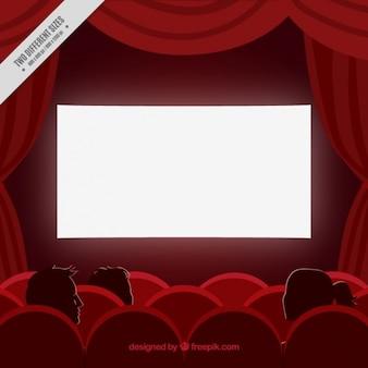 Cinéma fond rouge avec des rideaux et des fauteuils