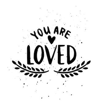 Citation. tu es aimé. lettrage de typographie dessiné à la main, pour la saint-valentin.
