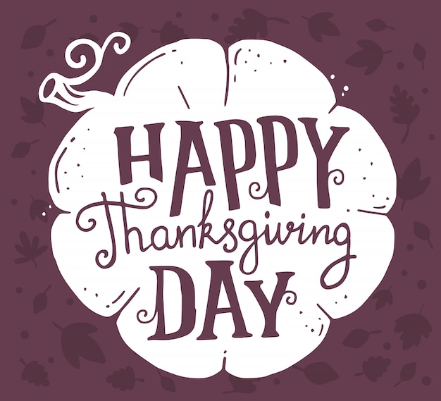 Citrouille blanche et texte joyeux jour de thanksgiving avec les feuilles de l'automne sur dark