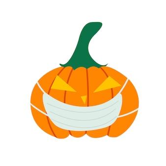 Citrouille dans un masque médical un symbole des vacances d'halloween
