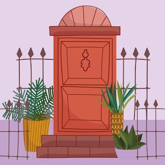 Clôture de porte et plantes