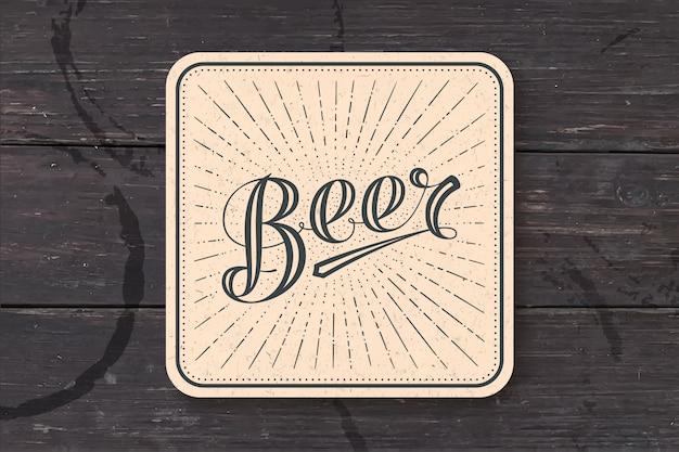 Coaster avec bière lettrage dessiné à la main