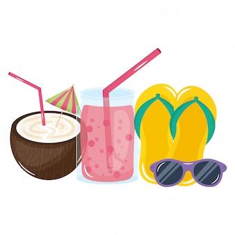 Cocktail de noix de coco tropical avec des tongs et des lunettes de soleil