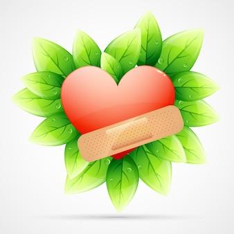 Coeur avec un bandage sur les feuilles vertes