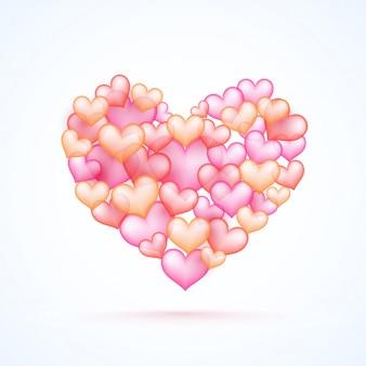 Cœur créatif fait de coeurs roses et rouges