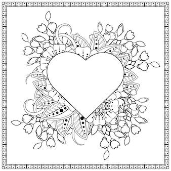Coeur dessiné à la main avec fleur de mehndi. décoration en ornement ethnique oriental, doodle.