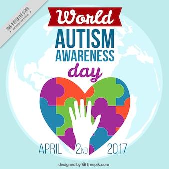 Coeur de fond avec des pièces colorées de la journée de l'autisme