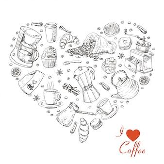 Le coeur isolé d'articles de café sur fond blanc