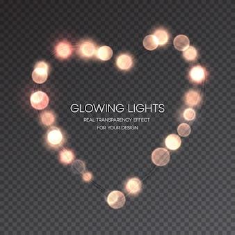 Coeur lumineux de saint valentin sur la transparence
