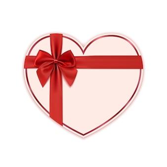 Coeur de papier avec ruban rouge et un arc.