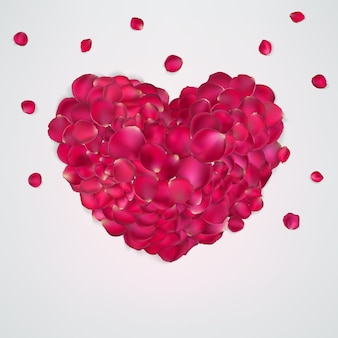 Coeur de pétales de rose rouges.