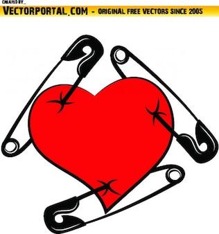 Coeur rouge percé avec des épingles noires
