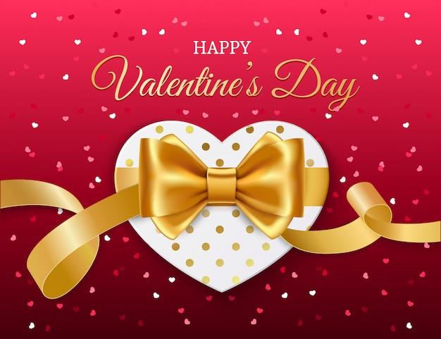 Coeur avec ruban doré et archet. la saint-valentin