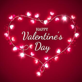 Coeur saint valentin avec ampoules rouges et roses